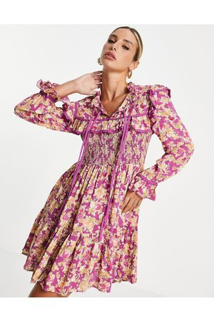 River Island Long sleeve shirred yoke mini dress in pink floral