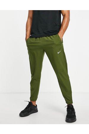 Nike Challenger Dri-FIT woven joggers in khaki
