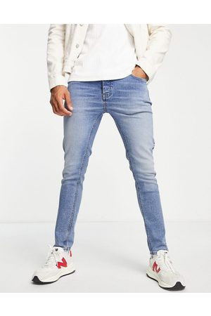 ASOS Organic cotton blend skinny jeans in tinted light wash