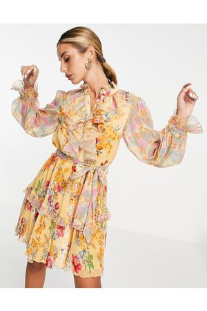 River Island Long sleeve frilly printed mini dress in yellow floral