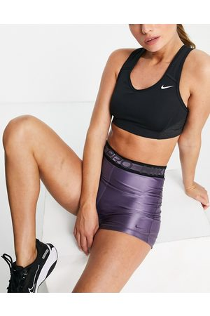 Nike Training Women Sports Bras - Nike Pro Training Dri-FIT Swoosh Sparkle medium support sports bra in