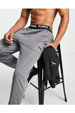 PUMA Training joggers with branded waistband in dark