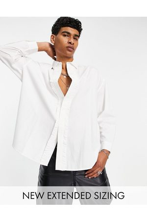 ASOS Extreme oversized shirt with ruffle front in