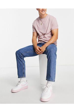 jack & jones Intelligence Chris loose fit jeans in midwash