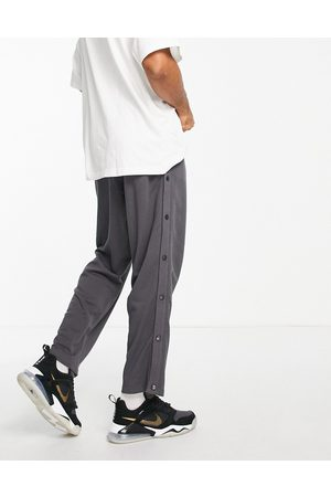 ASOS Oversized straight leg joggers with poppers in charcoal