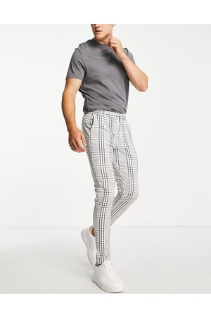 ASOS Super skinny smart trousers in crepe and navy check