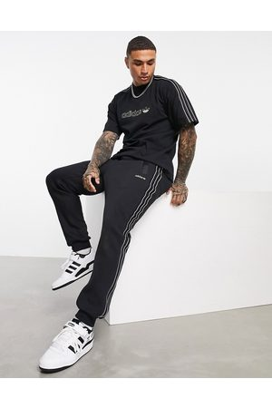 adidas SPRT satin panelled joggers in