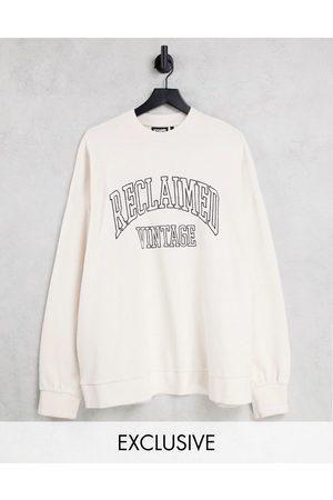 Reclaimed Inspired unisex oversized varsity sweatshirt with embroidered logo in ecru