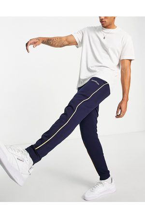 Reebok Men Joggers - Classics logo joggers with piping in navy