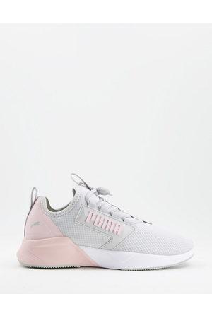 PUMA Training Retaliate mesh trainers in and pink