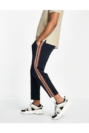 ASOS Men Joggers - Tapered fixed hem joggers with pin tucks & side tape in navy