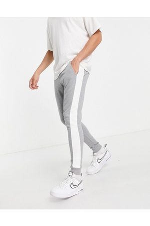 ASOS DESIGN Men Joggers - Skinny joggers with side stripe in marl