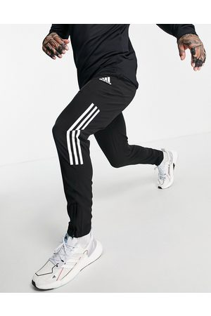 adidas Adidas Training joggers with three stripes in