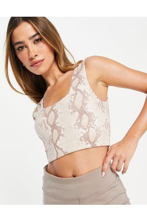 Varley Women Sports Bras - Delta medium support sports bra in champagne snake print