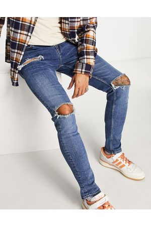 ASOS Skinny jeans in mid wash with heavy rips