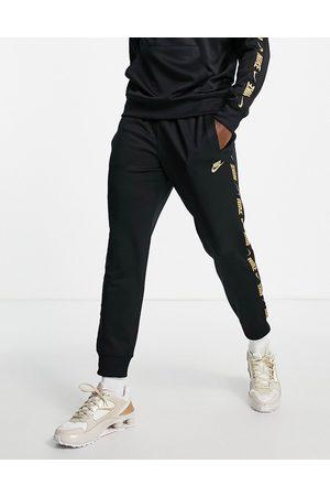 Nike Men Joggers - Repeat logo taping joggers in