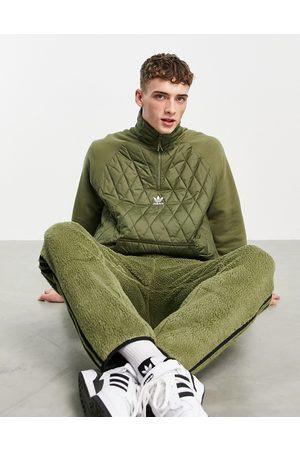 adidas Men Jackets - Adicolor quilted 1/4 zip jacket in khaki
