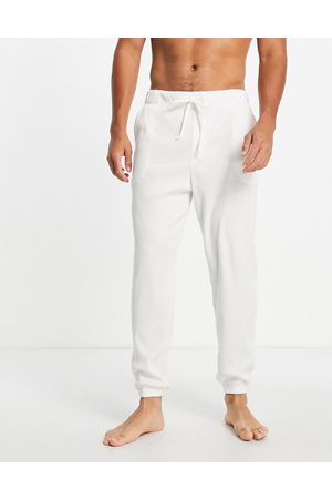 ASOS Lounge joggers in cream ribbed fabric