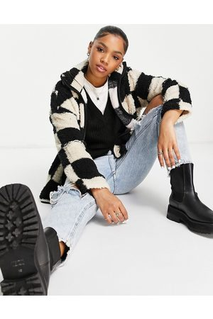 Monki Recycled polyester zip front checkerboard fleece in black and white-Multi